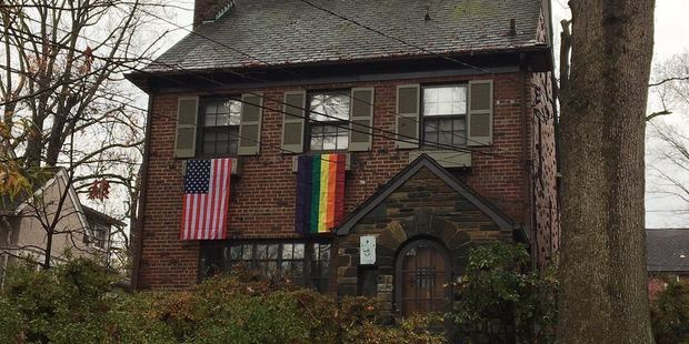 Mike Pence's new neighours have hung gay-pride rainbow flags in protest of his stance on LGBT rights. Photo / @ABC7Suzanne Twitter