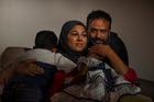 Saira Khan, the sister of Syed Rizwan Farook, sits with her husband, Farhan Khan, and their two children in Riverside, Calif. Photo / Washington Post, Jahi Chikwendiu