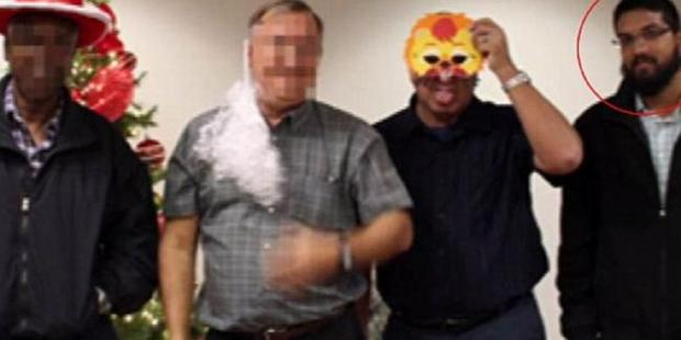 Syed Farook, right, attended a Christmas party shortly before his murderous rampage. Photo / ABC News