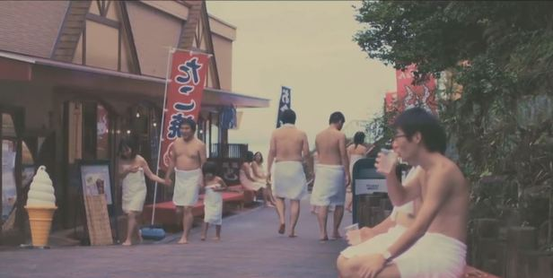 Visitors don towels to explore the park. Photo / YouTube