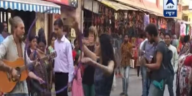 Tourists were filmed playing music and dancing with a hula hoop for cash. Photo / YouTube