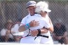 Prue Farnworth and Quentin Maisey celebrate their 65-plus mixed doubles title win yesterday. Photo / Duncan Brown