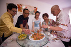 David Soh, William Chen, Alina Huang, Janet Chan and Charles Chan mix the New Year staple dish. Photo / Dean Purcell