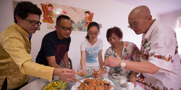 Loading David Soh, William Chen, Alina Huang, Janet Chan and Charles Chan mix the New Year staple dish. Photo / Dean Purcell