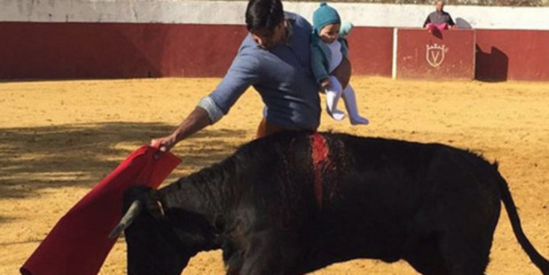 "Francisco ""Paquirri"" Rivera posted the photo of him with his five-month-old daughter while practising with a bull calf to his 60,000 followers on Instagram. Photo / Instagram"