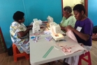 Women in Vanuatu are taught to sew on donated machines from New Zealand.