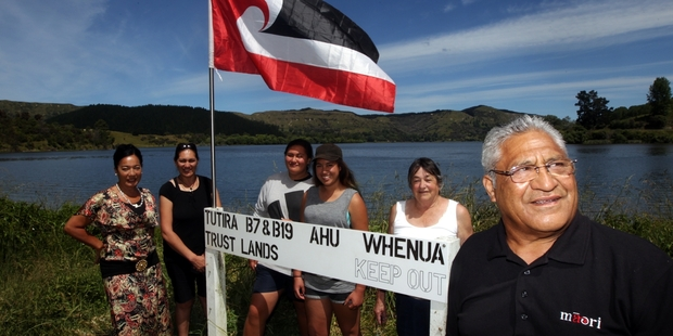 Trustees and family members Josephine Brown (left), Melissa Paul, Moana Crawford, Jesse Crawford, Phyllis Ratima, and Henare Ratima with the sign which was removed.