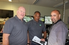 Stu Lyall (left) and James Werahiko (centre) in the Emergency Operations Centre at Rotorua Lakes Council getting a briefing from Richard Horn.