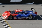 Scott Dixon crosses the Daytona finish line last year. Photo / AP