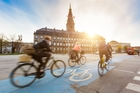 Whizzing by the Christiansborg Palace using the city's 400km cycle network is an incredible to way to experience Copenhagen. Photo / 123RF