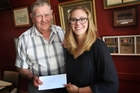 Steve Vautier, trust chairman, presents Emma Conley with her bursary award. Photo / Bevan Conley