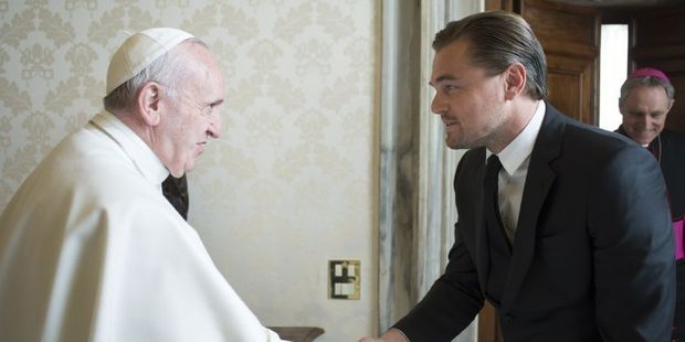 Pope Francis welcoming US actor Leonardo DiCaprio during a private audience at the Vatican. Photo / AFP
