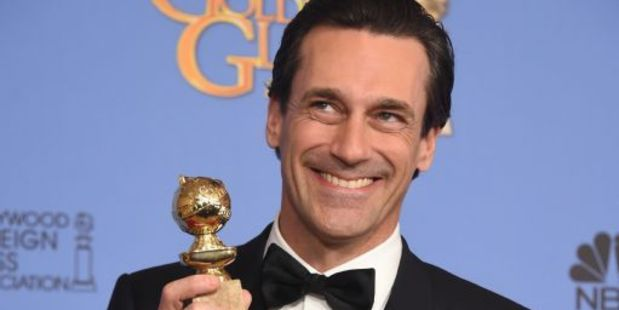 Jon Hamm poses with his award for Best Actor in a Television Series Drama for his role in Mad Men, at the 73nd annual Golden Globe Awards. Photo / AFP
