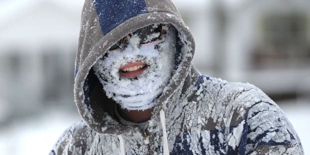 Michael Rainey got a face full of snow after tubing down the hill along Broad Street in Bristol, Tennessee. Photo / AP