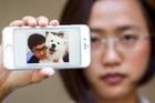 Heng Li, pictured on his friend Ying Dai's phone, drowned at Uretiti Beach on Christmas Day, 2014. Photo / New Zealand Herald