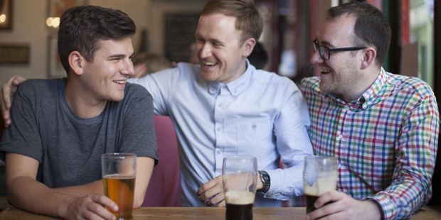 Male bonding is more likely to lower a man's stress levels than if he were to spend an evening with his partner. Photo / Getty