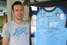 SWISS TIMING: Daniel Fasnacht with his prized Weggis Floorball Club shirt signed by his old teammates.