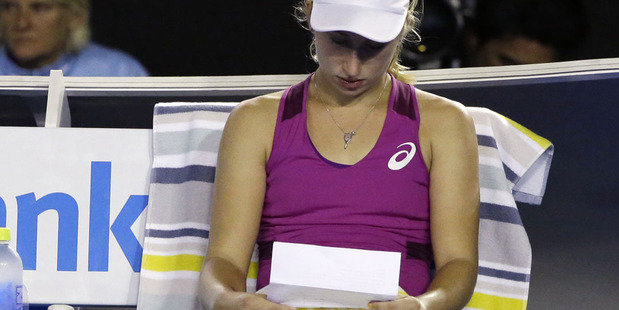 Daria Gavrilova of Australia reads a piece of paper during a break in her fourth round match against Carla Suarez Navarro. Photo / AP