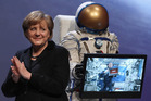 German Chancellor Angela Merkel celebrates the country's space programme in 2012. So which space hero came to the rescue of injured biker? Photo / Getty Images