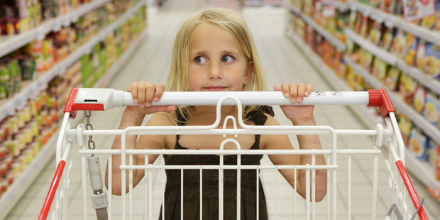 Products targeting children are placed at their eye level and made easily accessible to them. Photo / Getty