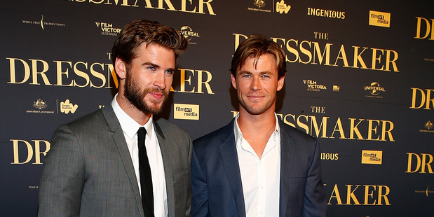 Chris Hemsworth (right) denies any knowledge of brother Liam's (left) rumoured engagement to Miley Cyrus. Photo / Getty