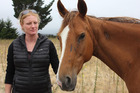 Nicky Sygrove, of Wanaka, with Misty the horse, who almost died on Saturday after being left tied to a tree by a stranger. Photo / Otago Daily Times / Margot Taylor