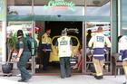 Emergency crews treat injured customers at the Cheesecake Shop in Whangarei. Photo / Michael Cunningham
