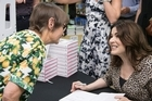 Domestic goddess and award-winning author Nigella Lawson is charming fans in Newmarket as she signs copies of her latest book, Simply Nigella.