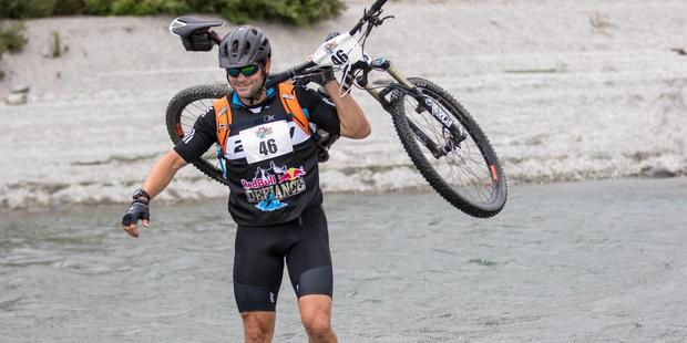Richie McCaw completed the initial mountain bike stage of the Red Bull Defiance multisport event as part of his training for GODZone event in April. Photo / Supplied