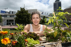 Emily Harris with her city-grown veges in Aotea Square. Photo / Doug Sherring.