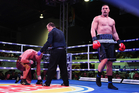 New Zealand Heavyweight boxer Joseph Parker knocks down American Southpaw Jason Bergman during the Rumble in Paradise. Photo / Photosport.co.nz