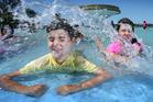 Luka, 8, and India, 11 Mahy enjoy playing in the Memorial Park fountain. Photo/John Borren