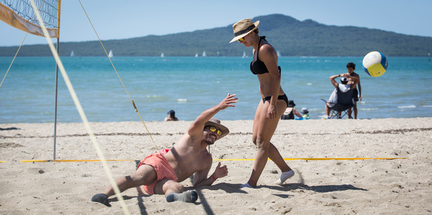 Thiago Rocha and Victoria Sedykh play volleyball at a sunny Mission Bay yesterday. Photo / Greg Bowker