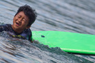Six year old Arthur Thayaparan cools off in the Blue Lake yesterday.  Photo/Ben Fraser