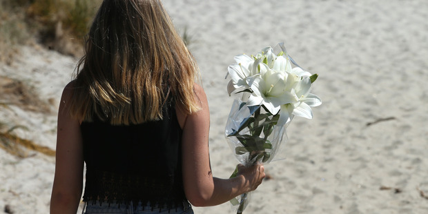 Teenagers gathered at the end of Leisure Island to pay tribute to Hamish Rieger. Photo/John Borren