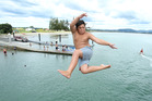 Taking the Plunge/ Tamanui Pungatara spends his 13th birthday cooling off near the Bridge Marina. Photo/John Borren.
