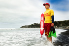 Wellington surf lifesaver Nick Mulcahy out patrolling beaches. Photo / Martin Hunter