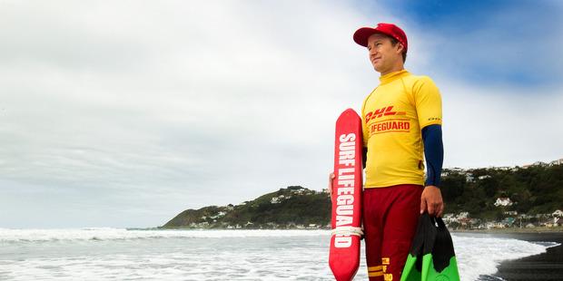 Wellington surf lifesaver Nick Mulcahy out patrolling beaches. Photo / Martin Hunter