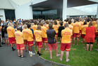 The entrance to the church was a sea of yellow and red. Photo/Andrew Warner
