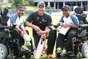 The Black caps meet disabled brothers Ashvin and Arvinth Sathiyaseelan at Eden Park. Photo / Doug Sherring
