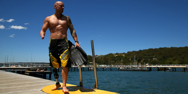 Paul de Gelder lost an arm and a leg when he was attacked by a male bull shark while working as a Navy Clearance Diver in Sydney Harbour in February 2009. Photo / Getty Images