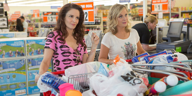 Tina Fey, left, as Kate Ellis and Amy Poehler as Maura Ellis, in a scene from Sisters. Photo / AP