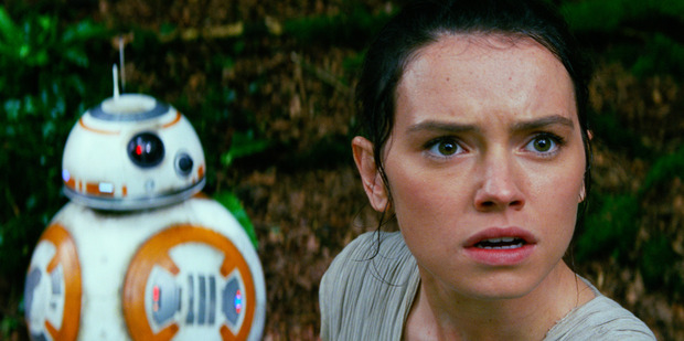 Daisy Ridley as Rey, and BB-8, in a scene from the film, Star Wars: The Force Awakens.
