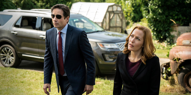 David Duchovny as Fox Mulder and Gillian Anderson as Dana Scully in The X-Files.