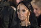 Celine Dion looks on as the casket of her husband Rene Angelil is taken away. Photo / AP