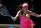 Agnieszka Radwanska of Poland plays a forehand return to Carla Suarez Navarro of Spain during their quarterfinal match at the Australian Open. Photo / AP.
