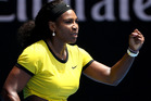 Serena Williams of the United States celebrates after inning a point against Maria Sharapova of Russia during their quarterfinal match at the Australian Open. Photo / AP.