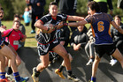 Tane Te Rangi, 18, will join the Penrith Panthers junior set-up this year. He is pictured (centre) playing for Pikiao under-17s last year. Photo / Ben Fraser