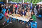 Auckland Night Market co-owners Paul de Jong and Victoria Yao (centre) join friends for a meal at the Botany Town Centre on Wednesday. Photo / Greg Bowker