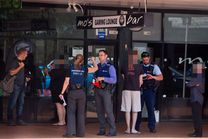 Police investigate the robbery at Mo's Bar last Sunday. Photo/Ben Fraser